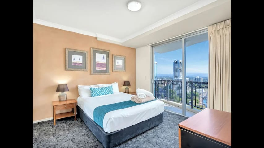 Master bedroom with a queen bed and 2nd balcony and view