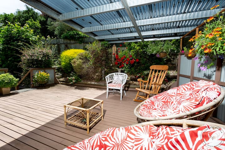 Make yourself comfortable in our secluded, private back patio and garden!