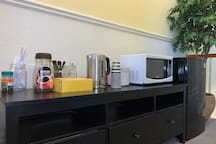 Microwave, mini fridge, kettle, coffee, tea, water provided for your convenience