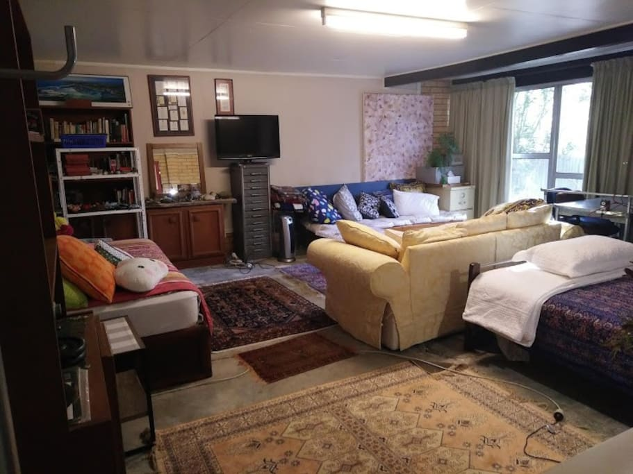 Large room with Super comfy lounge and TV
