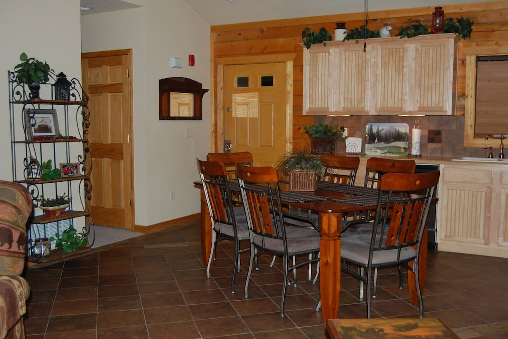 Full size kitchen with plenty of cabinets, counter space & table seating for six