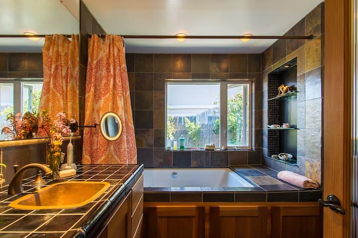 Heated slate floor spa for two bath, copper sink, luxury adjustable lights
