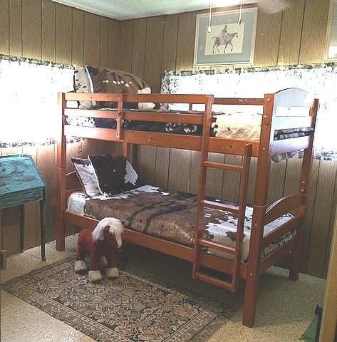Comfortable bunkbeds with fleece cowhide to snuggle in. Available for up to 6 adults or children at an additional charge to combine with the studio apartment for a full house!