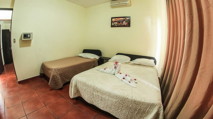 Bedroom with A/C unit: 1 Double and 1 Single bed