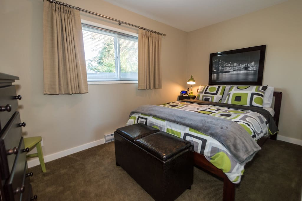 Queen Size Bed and black out drapes in bedroom
