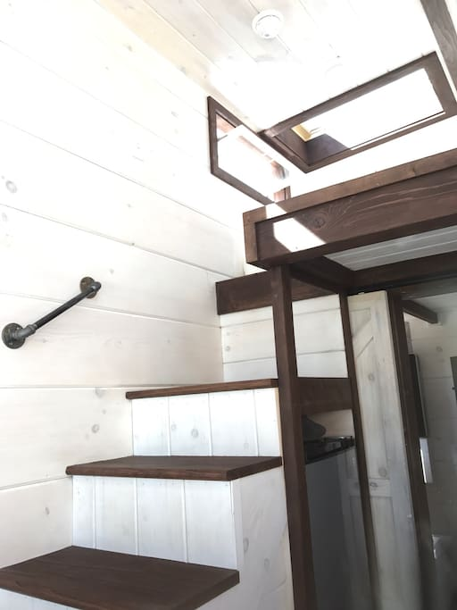 Stairs to the loft with a memory foam Queen size memory bed. Skylight over the bed where you can fall asleep under the stars.