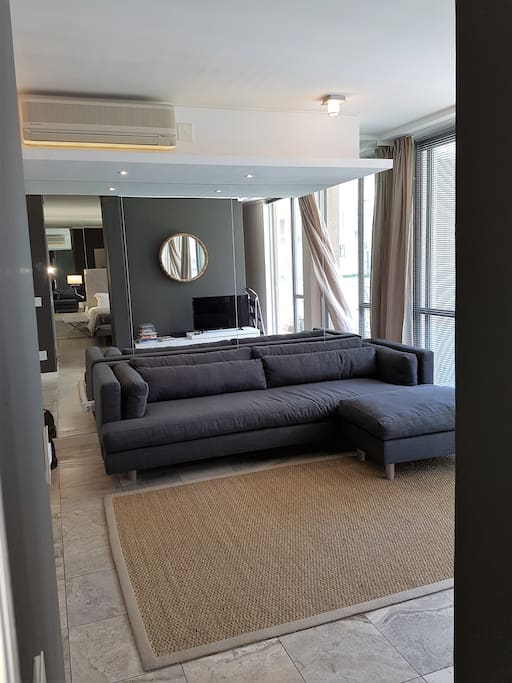 Beautifully furnished with light streaming in through the double sliding doors