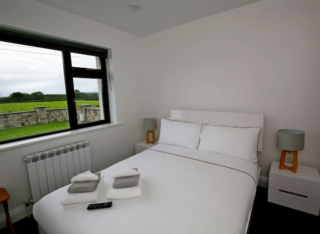 Bedroom Number 2 with ample closet/storage space with your own personal TV. Your sheets/duvets freshly laundered-Your bed made to perfection by a master bed maker. Stunning southern views of the front lawn and our surrounding lush green fields