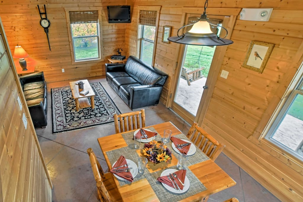 Featuring 2 flat-screen TVs and an expansive yard, this cabin ensures comfort throughout your stay.