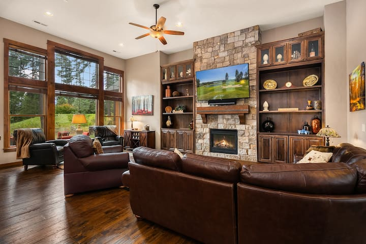 Large TV with Dish, and a gas fireplace.