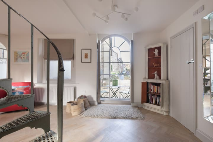 Arched window looking out to front of house and Bath Street