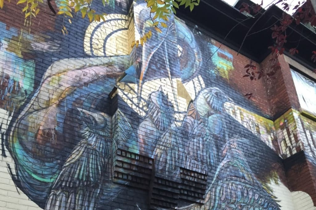 Giant Mural on side of the Art House Airbnb - done by a local tattoo artist