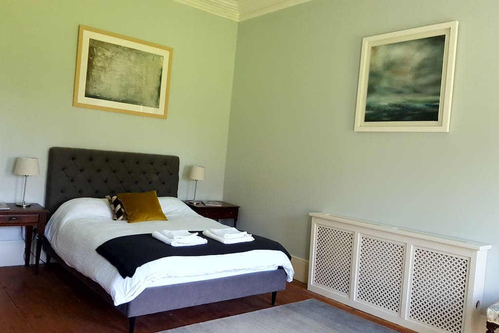Bedroom 1 - 1 King size bed. A bright, spacious room with original coving, high ceilings and a marble fireplace