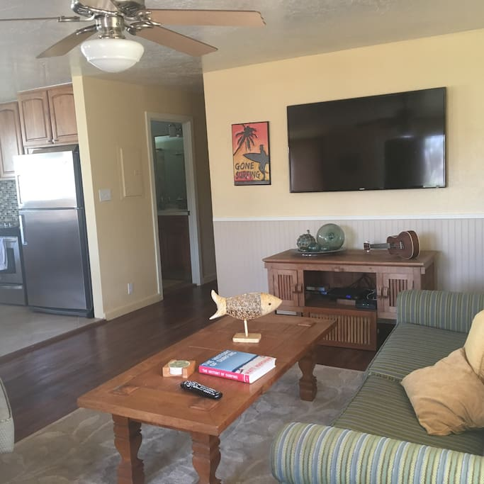 Living room with Smart TV & WiFi.  Couch and 2 large occasional chairs