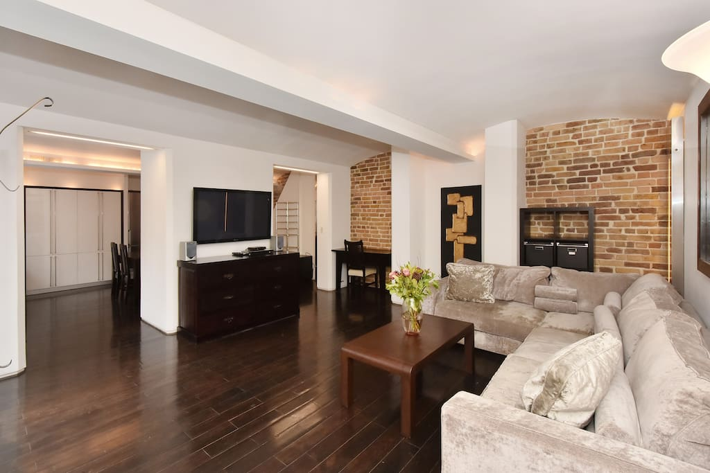 The chic, elegant and spacious Lounge with kitchen and dining area beyond