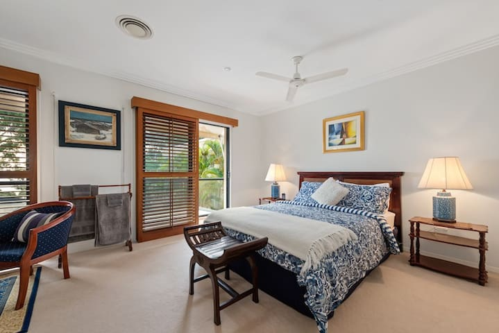 Second Bedroom with sitting area + balcony overlooking pool