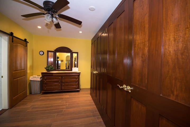 Double armoire with bureaus and sliding barn door for gorgeous ensuite bathroom. Lovely private shower and changing area.