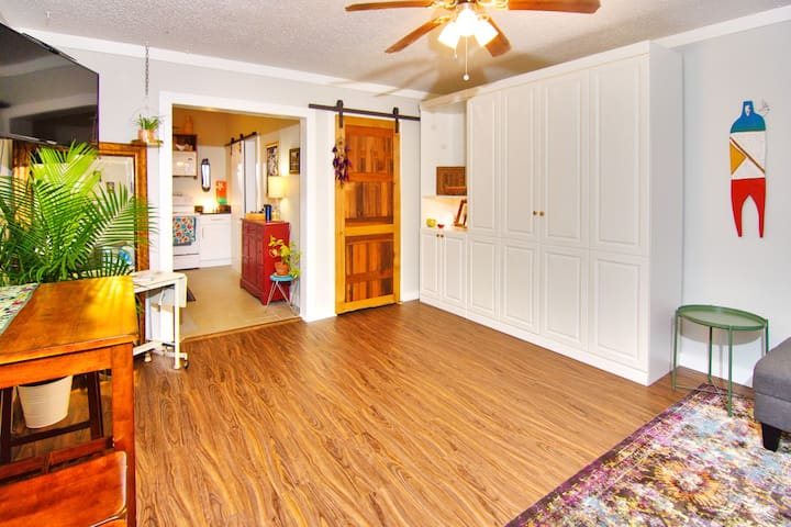 Welcome to Studio San Marco. The custom Murphy bed is Queen size, and easy to use. The adjoining bookcase in the furniture allows for hanging of clothes and storage.  Just outside of the picture frame is a comfy couch with chaise seating