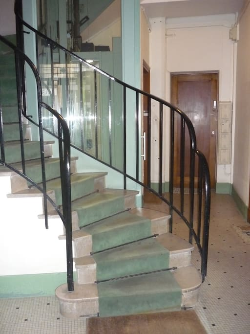 Lobby with stairs and elevator