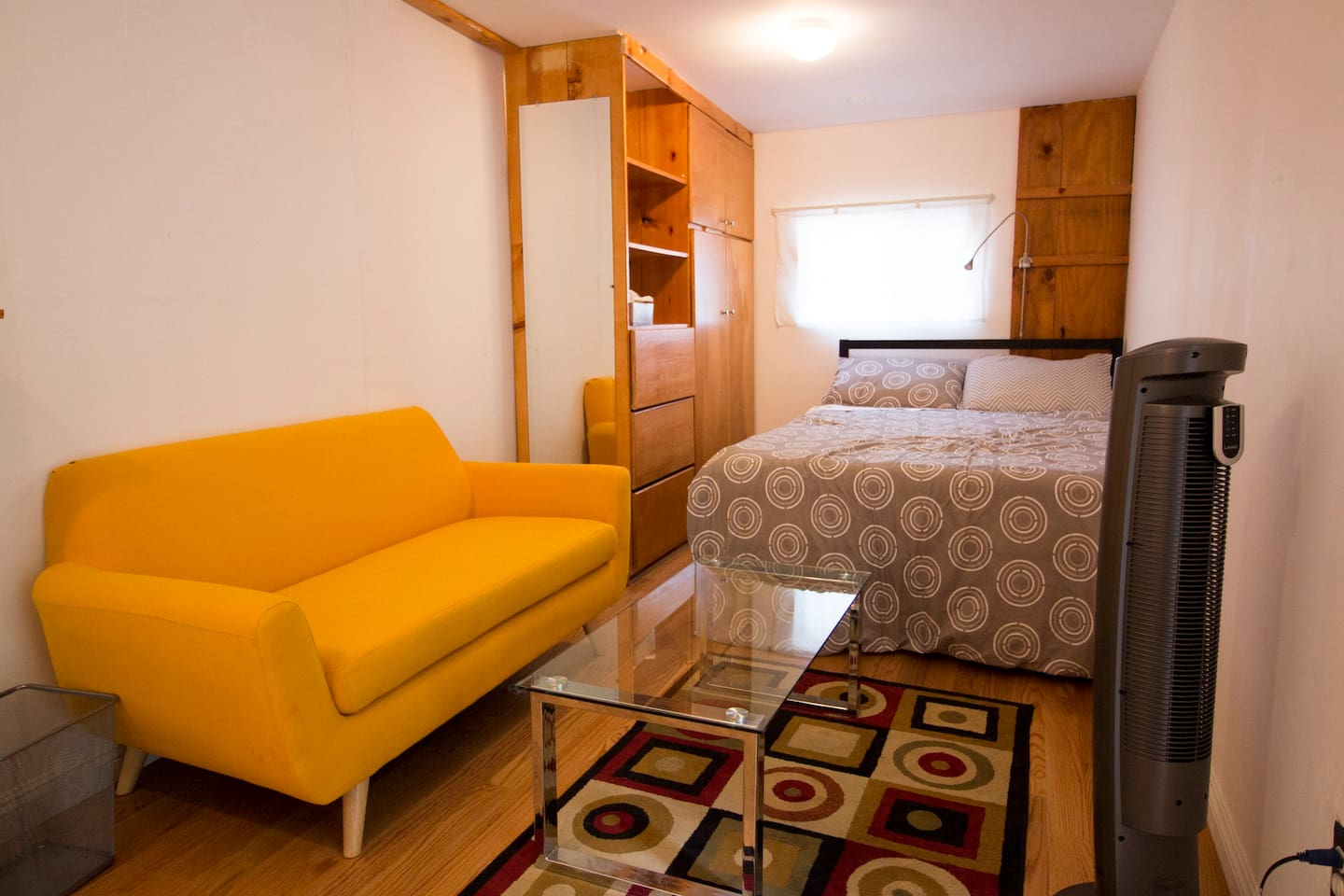 Full-sized bed. Small sofa and table. Closet space. Fan.