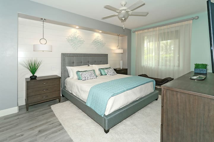 This spacious master bedroom will let you know you are on vacation.