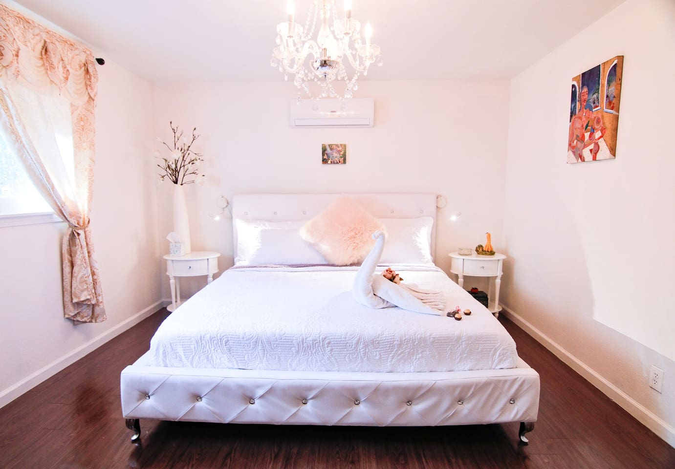 bedroom 1 with king size bed and bedding