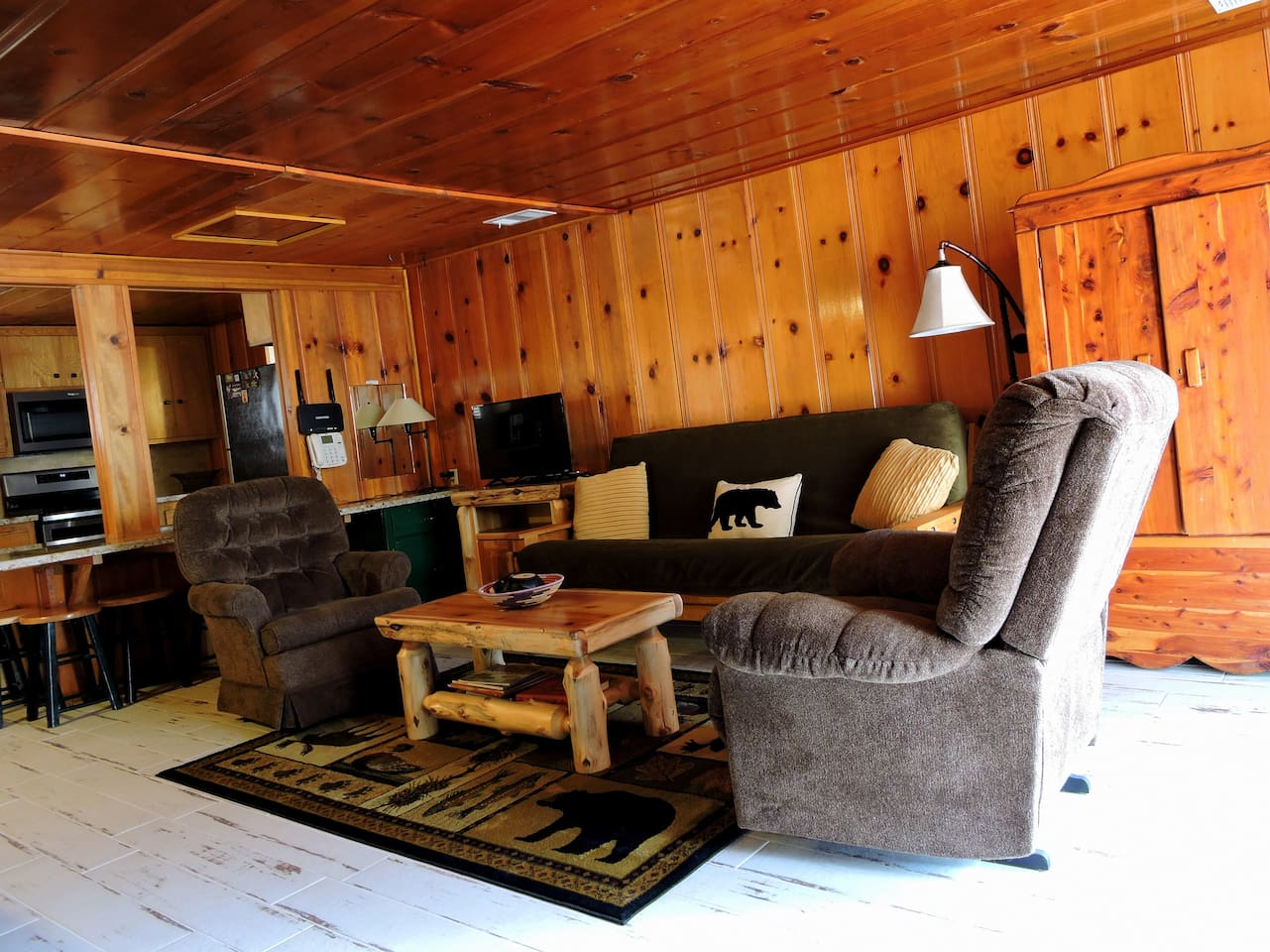 The cozy living room is off the kitchen and boasts a river rock fireplace for chilly mountain nights.