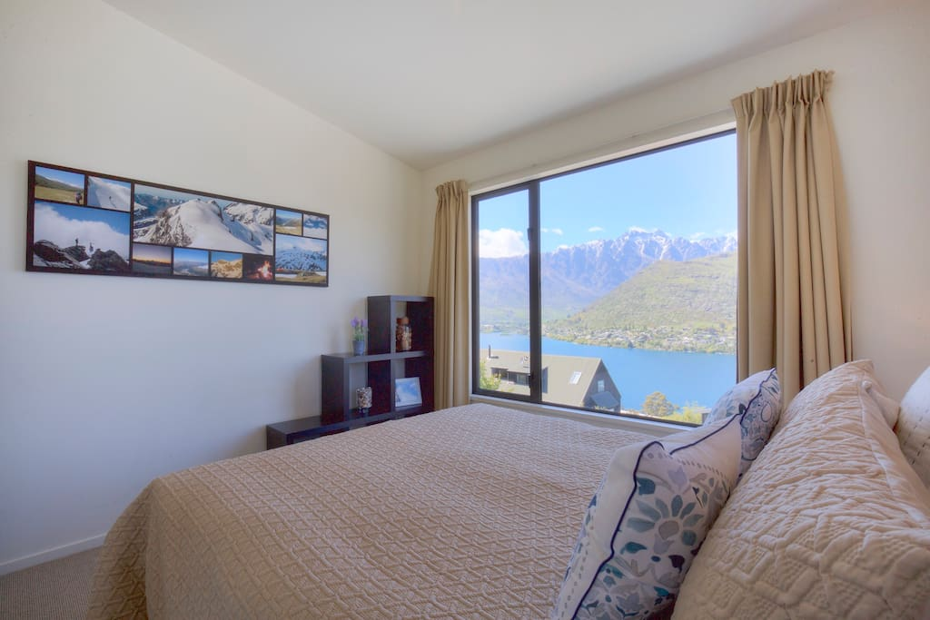 Guest Bedroom, with views of the lake and mountains. Includes luxury linen, large spacious wardrobe. Fully double glazed.