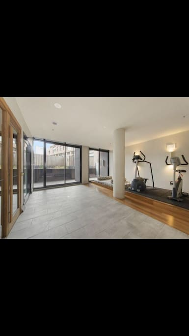 Gym downstairs with sauna and steam room.