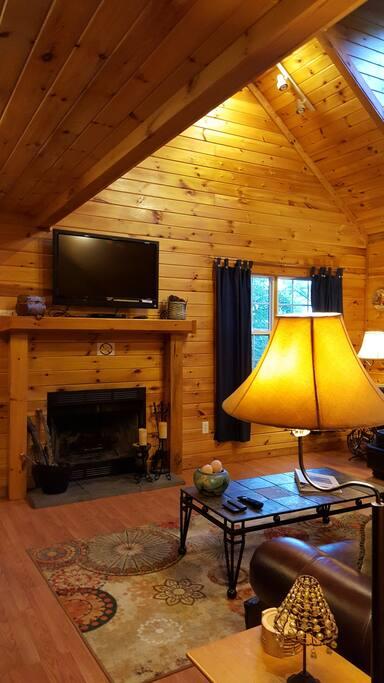 Wood Paneled Great Room with Wood Burning Fireplace