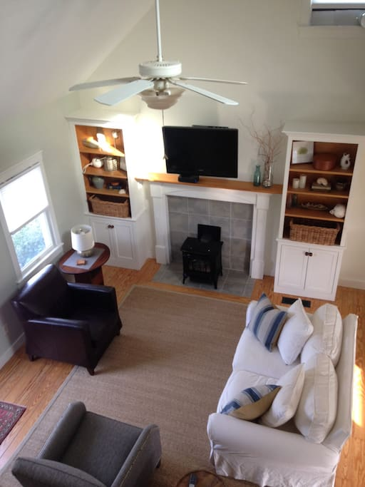 Living area with seating TV and gas stove