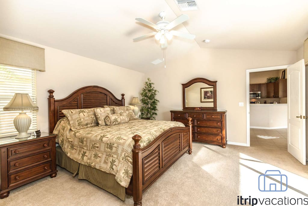 Split bedroom floor plan presents this private & richly appointed master bedroom (king bed) suite, located off dining room.