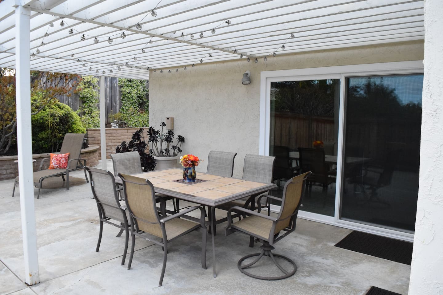 Fun solar lights over patio table create great evenings for entertaining