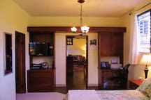 LOOKING FROM BEDROOM TO KITCHEN AND DINING.  OFFICE SPACE IN BEDROOM.