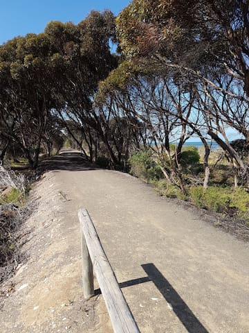 The levy turns into a walking/bike track that goes all the way into Kingscote