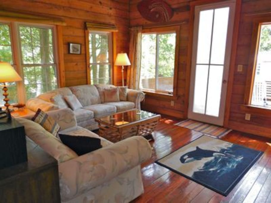 Spacious living area with door leading to the front deck