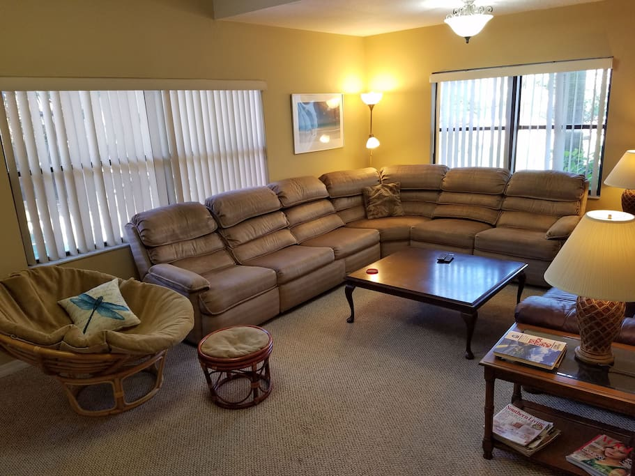 In living Room sectional couch has two Lay-Z-Boy reclininers and a sleeper sofa. Also: a comfy leather couch.  55-inch TV (not shown; behind picture taker) w/local channels, Netflix. BluRay player with many movies on hand. A very accommodating place.
