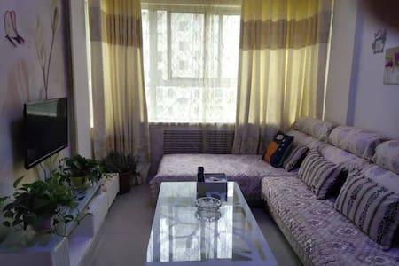 武威天马湖畔简约公寓民宿