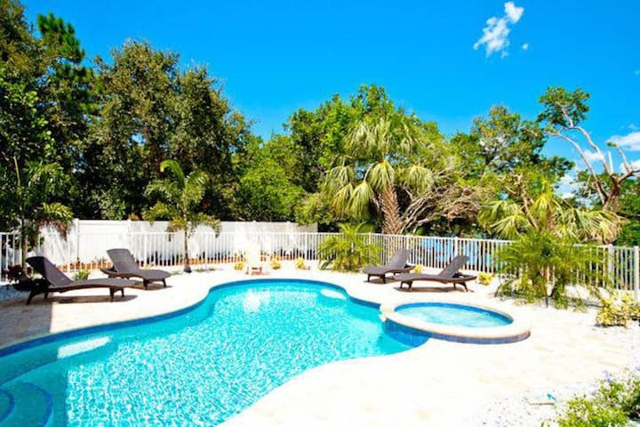 Canalfront home w/ heated pool, dock & lanai - 2 blocks to the beach!