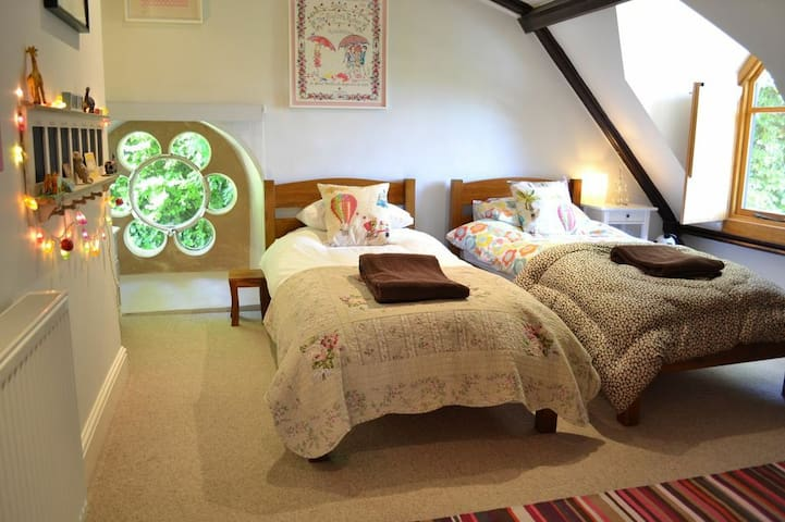 Bedroom 3 sleeps 4, 2 single beds and a set of bunk beds.