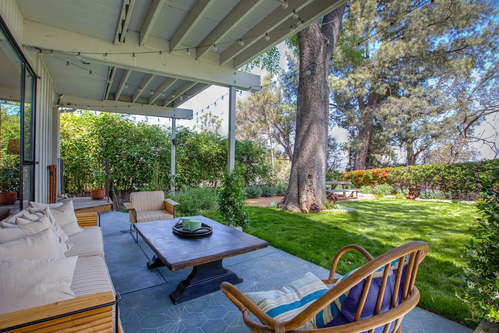 Enjoy chit-chat at a sitting area on the backyard patio.