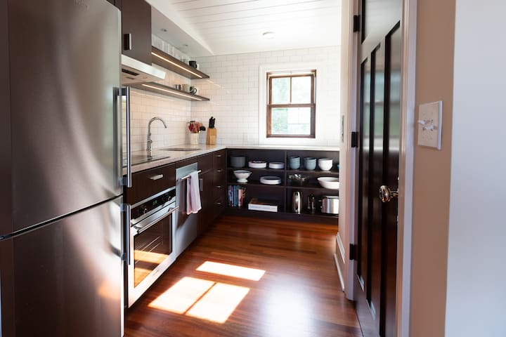 The kitchen is fully-appointed with a four burner induction range, oven, refrigerator, dishwasher, microwave, ample kitchen utensils and plenty of coffee-making options - if you need something else please let us know - we probably have it and can bring it up to you!