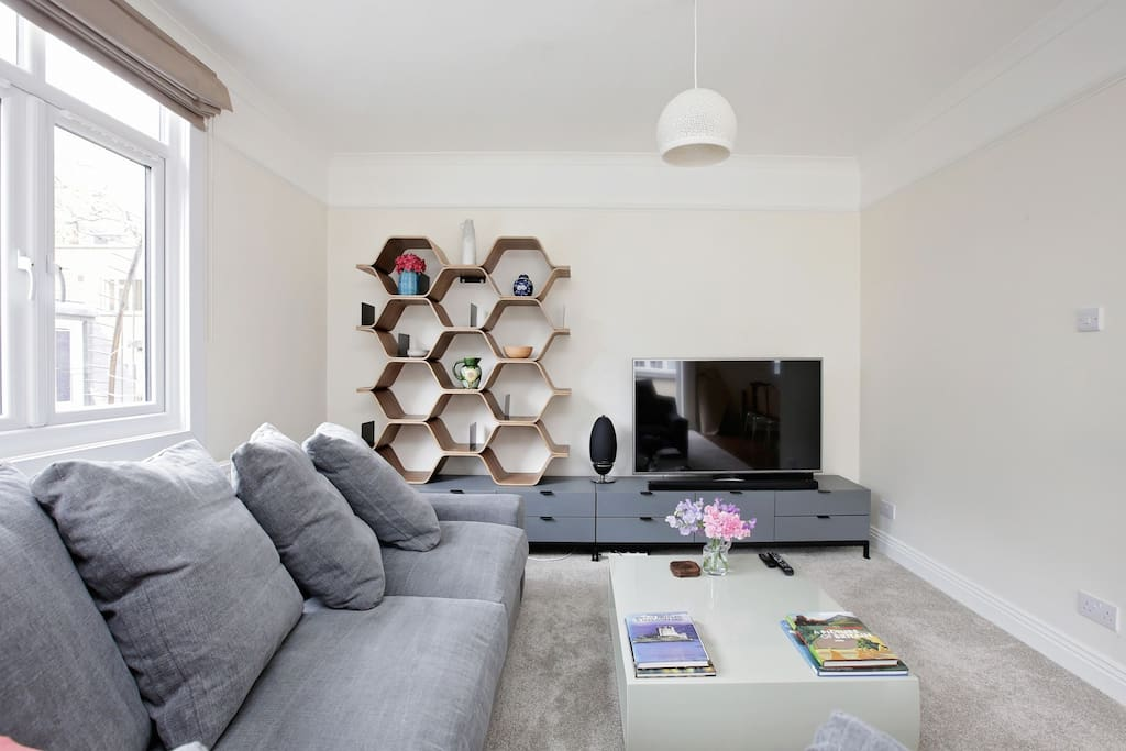 Living area with large flat screen TV with sound bar