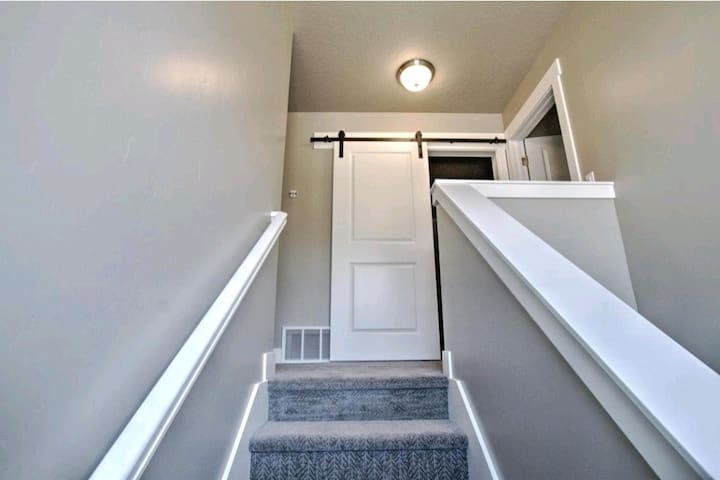 Stairs leading upstairs to 2nd living room, 3 more bedrooms and 2 more bathrooms.