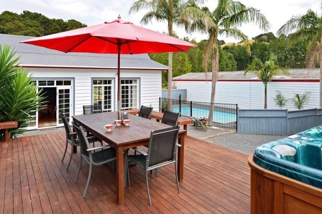 Outdoor entertaining area, off the dining room, overlooking pool and driveway
