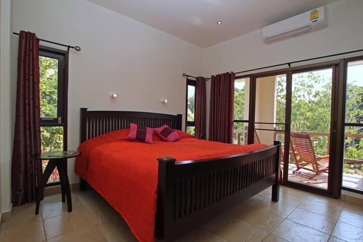 1st floor bedroom with balcony.