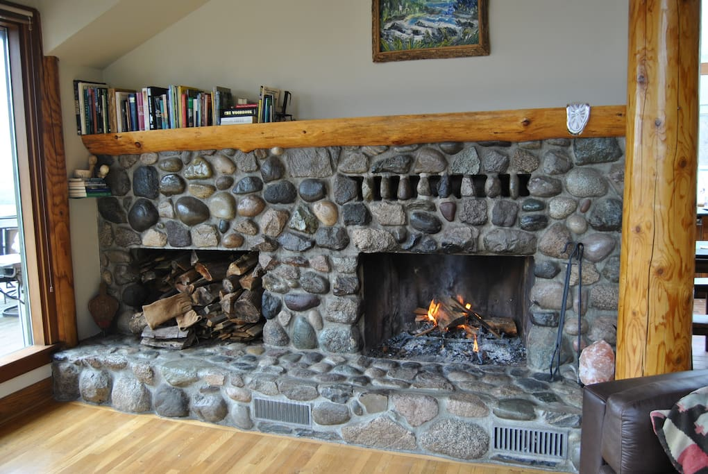 Local river rock fireplace with wood from our property for y'all to enjoy...