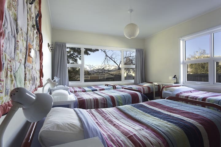 Spacious room with 6 single beds