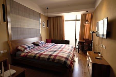 大理洱海边国际生态城半岛度假幽兰公寓in Dali - Dali - Appartamento con trattamento alberghiero