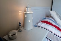 Little touches in the bedroom help to remind you of the seaside.